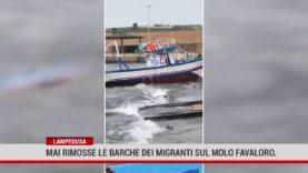 Lampedusa. Mai rimosse le barche dei migranti sul molo Favaloro
